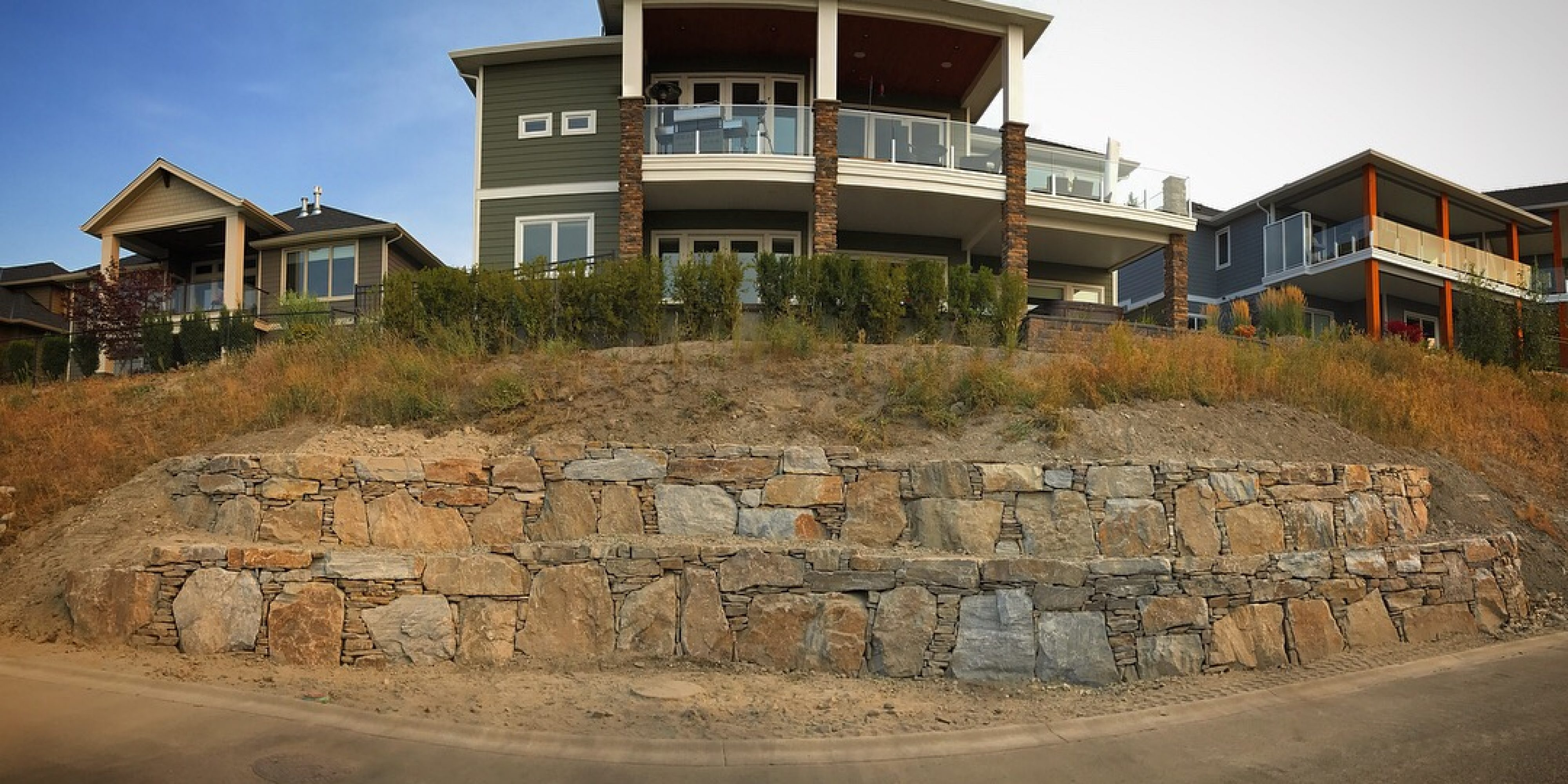 rock wall in front of house
