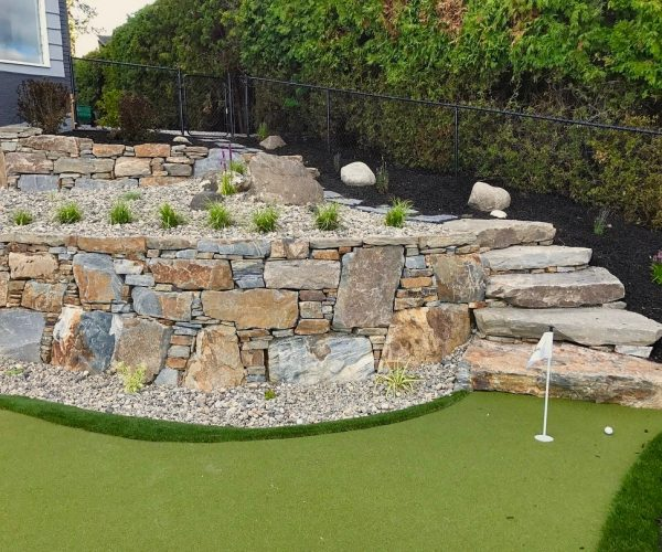 golf course and rock wall