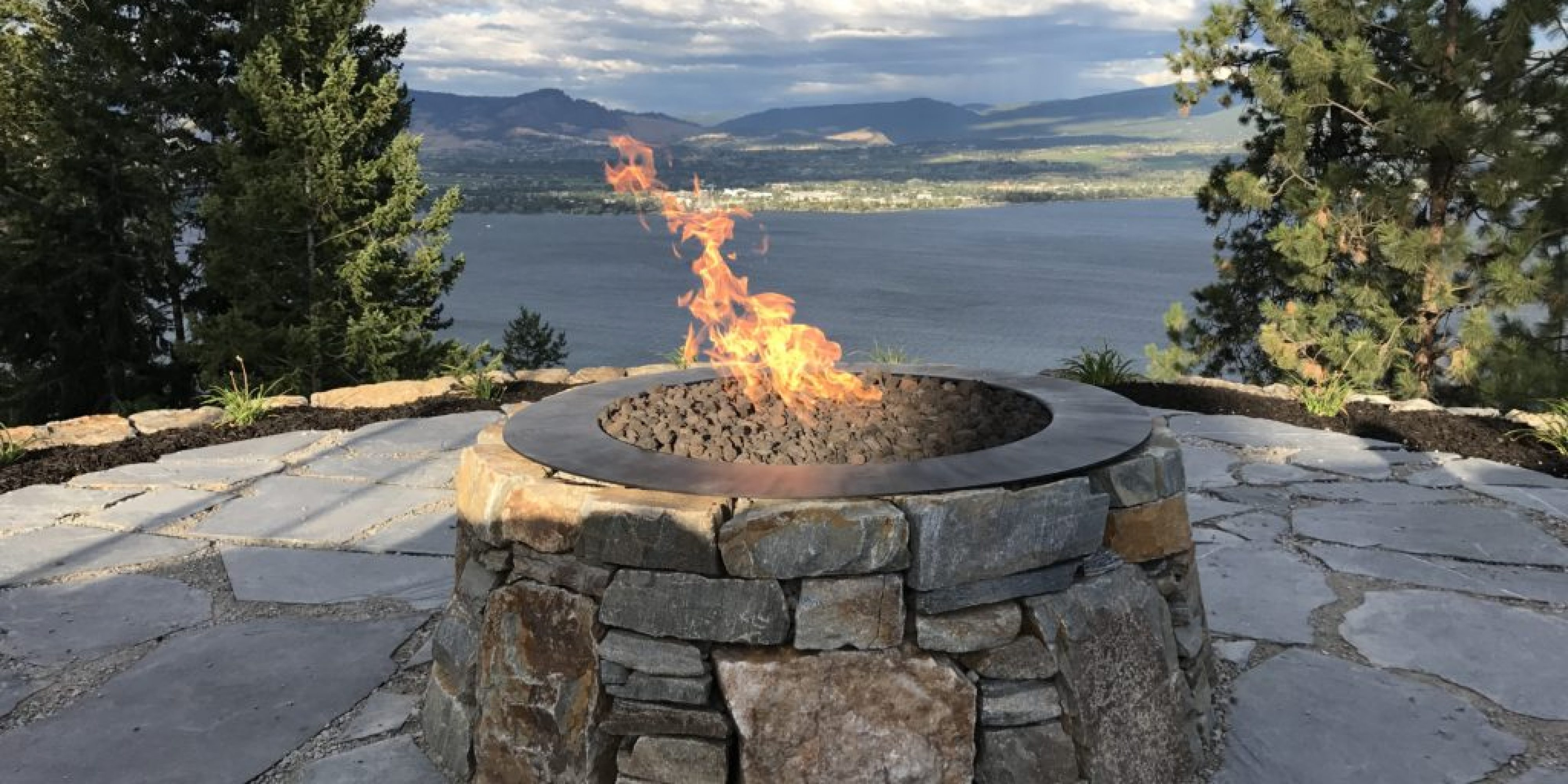 fire pit overlooking a lake