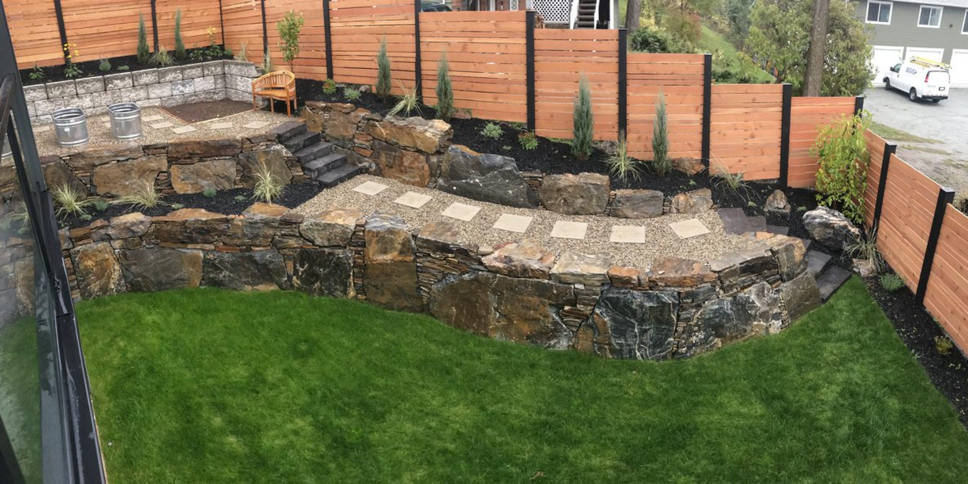 rock wall with pathway through garden